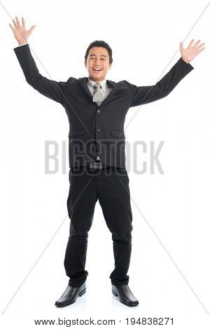 Full body front view attractive young Southeast Asian businessman arms raised and jumping, isolated on white background.