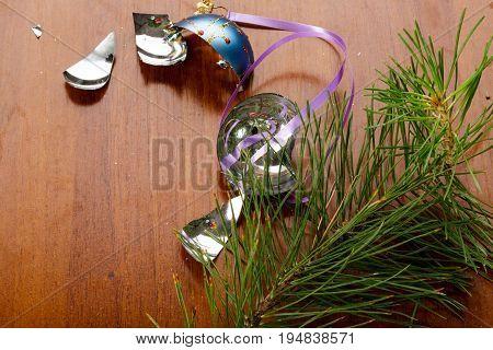 Broken xmas glass ball on wood table