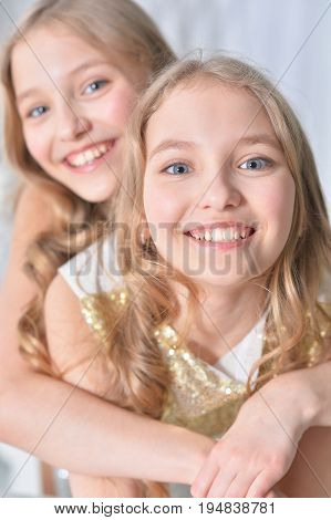 Portrait of a cute twin sisters close up