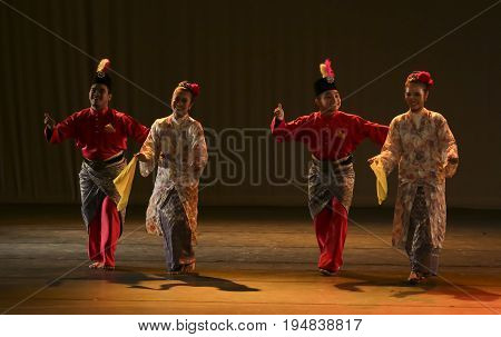 KUALA LUMPUR MALAYSIA - NOVEMBER 15 2016 : Man and women performing Malaysia traditional dance during public event.