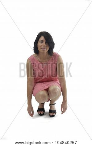 Woman With A Dress Crouching On A White Background