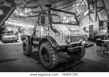 STUTTGART GERMANY - MARCH 18 2016: Multi-purpose auto four-wheel drive medium truck produced by Mercedes-Benz Unimog U600 1980. Black and white. Europe's greatest classic car exhibition