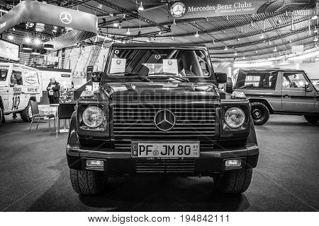STUTTGART GERMANY - MARCH 18 2016: Mid-size luxury SUV Mercedes-Benz G500 Convertible 2001. Black and white. Europe's greatest classic car exhibition