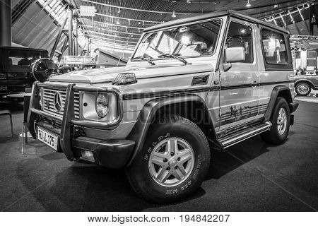 STUTTGART GERMANY - MARCH 18 2016: Mid-size luxury SUV Mercedes-Benz 300 GD 1990. Black and white. Europe's greatest classic car exhibition