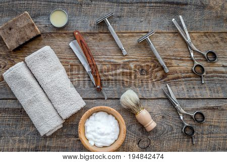 Preparing for men shaving. Shaving brush, razor, foam, sciccors on wooden table background top view.