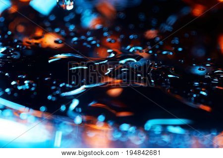 Abstract close-up photo of the colorful liquid surface