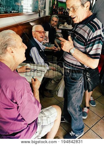 Milan Italy - June 11 2017: morning a friendly conversation of older men at cafe