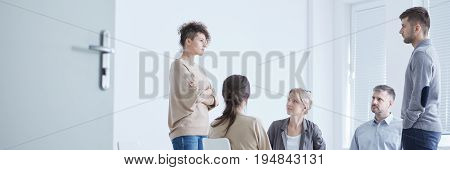 Support group watching young couple emotionally focused during drama therapy
