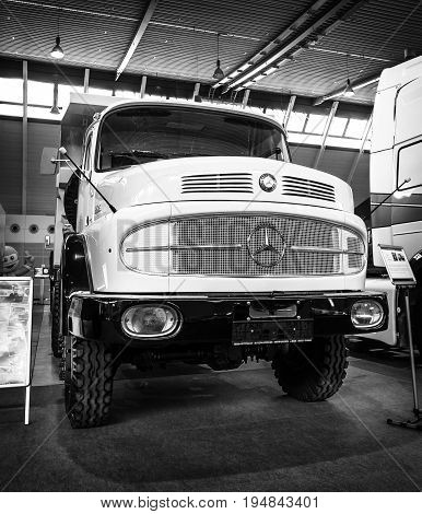 STUTTGART GERMANY - MARCH 18 2016: Heavy truck Mercedes-Benz LAK 2624 6X6 Mulde 1974. Black and white. Europe's greatest classic car exhibition
