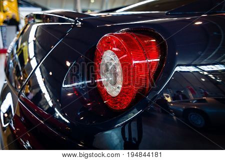 STUTTGART GERMANY - MARCH 18 2016: The rear brake lights of sports car Ferrari 599 GTB Fiorano F1 2008. Europe's greatest classic car exhibition