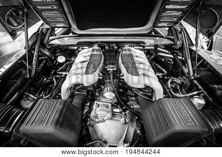 STUTTGART GERMANY - MARCH 18 2016: Engine of sports car Ferrari F512 M Testarossa 1995. Black and white. Europe's greatest classic car exhibition