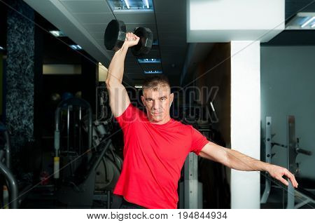 Man dumbbell workout in the gym. Gym training.