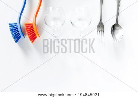 Wash dishes. Tableware and liquid on white background top view.