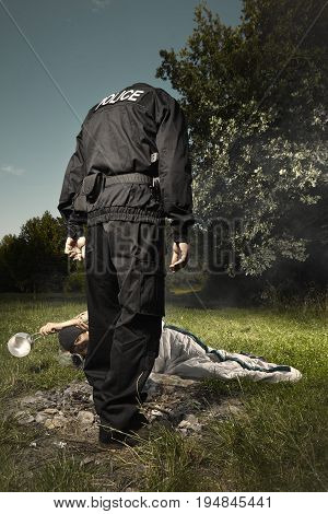 Vagabond young man sleeping in park checked by police patrol