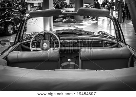 STUTTGART GERMANY - MARCH 18 2016: Cabin of Mercedes-Benz 220 SE (W128) cabriolet 1962. Black and white. Europe's greatest classic car exhibition