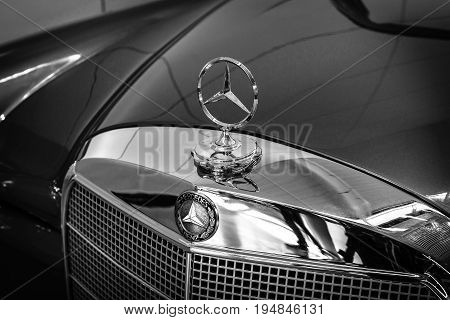 STUTTGART GERMANY - MARCH 18 2016: Hood ornament of Mercedes-Benz 220 SE (W128) close-up. Black and white. Europe's greatest classic car exhibition
