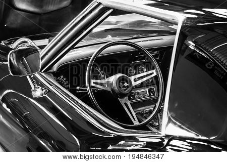 STUTTGART GERMANY - MARCH 18 2016: Cabin of sports car Chevrolet Corvette (C3) Stingray Coupe. Black and white. Europe's greatest classic car exhibition