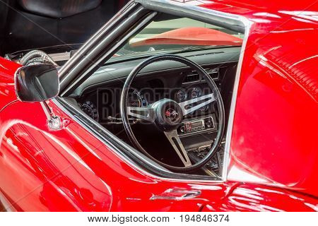 STUTTGART GERMANY - MARCH 18 2016: Cabin of sports car Chevrolet Corvette (C3) Stingray Coupe. Europe's greatest classic car exhibition