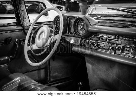 STUTTGART GERMANY - MARCH 18 2016: Cabin of full-size luxury car Mercedes-Benz 280 SE 3.5 Coupe (W111) 1970. Black and white. Europe's greatest classic car exhibition