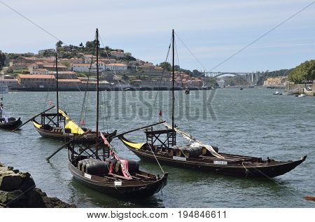 GAIA, PORTUGAL - AUGUST 7, 2015: Wooden boats with wine barrels at the river Douro in Gaia located south of the city of Porto on the other side of the Douro river Portugal.
