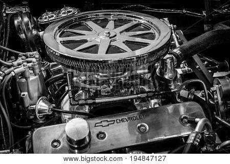 STUTTGART GERMANY - MARCH 18 2016: Engine ZZ4 of sports car Chevrolet Corvette Roadster Black Old-School Resto Mod 1967. Black and white. Europe's greatest classic car exhibition