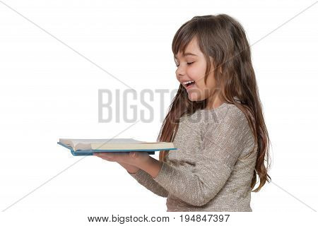 Laughing long haired little girl is holding a book. All is on the white background.