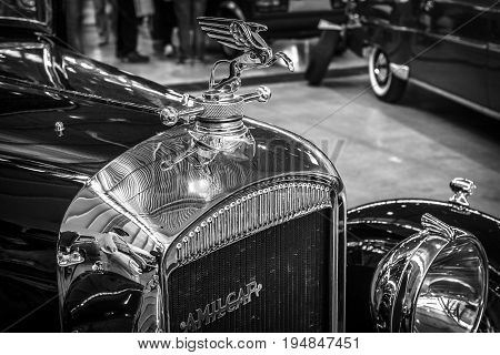 STUTTGART GERMANY - MARCH 18 2016: Hood ornament of vintage car Amilcar M3 1932. Black and white. Europe's greatest classic car exhibition