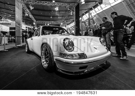 STUTTGART GERMANY - MARCH 18 2016: World premiere of Restomod Porsche 911and 933 equipments by Kaege Retro 2016. Black and white. Europe's greatest classic car exhibition