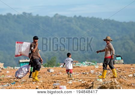 Kota Kinabalu, Malaysia - 09 July, 2017: People At The Landfill Site In Sabah, Borneo. They Scavenge