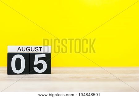 August 5th. Image of august 5, calendar on yellow background with empty space for text. Summer time.