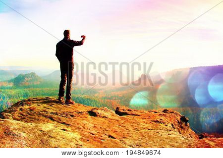 Film Grain. Slim Tourist On The Cliff Of Rock In Rock Empires Park  Is Watching Over The Misty And F