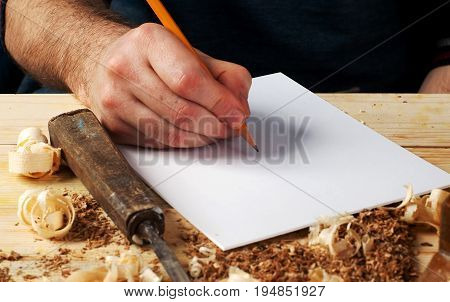 carpenter working, hammer, meter and screw-driver on construction background.