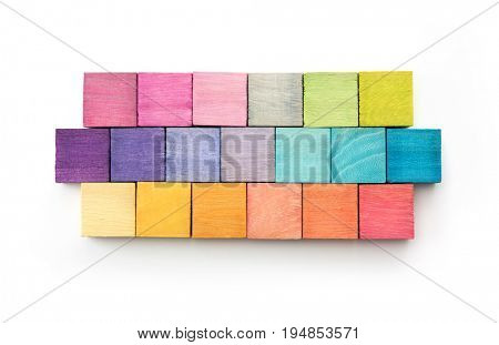 cover or web site menu bar abstract background, consisting of colored wooden blocks. On isolated white background. light pink, green , yellow, orange, blue to purple.