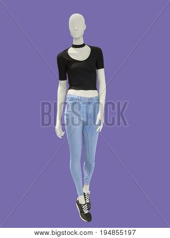 Full-length female mannequin dressed in blue jeans and black top isolated. No brand names or copyright objects.