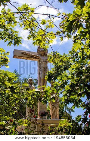 A wooden cross a crucifix against the blue sky