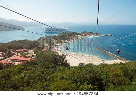 People doing zip line in caribbean coast on vacation. Cruise vacation theme