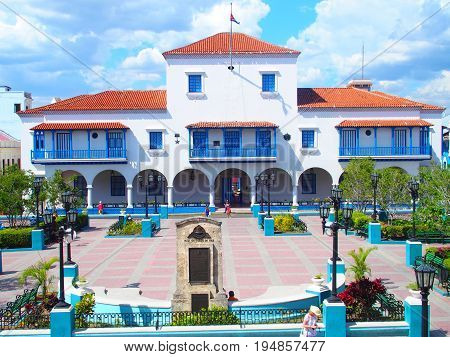 City hall in SANTIAGO de CUBA town with beauty colorful square and cloudy blue sky in 2017 warm sunny spring day, NORTH AMERICA on MARCH.