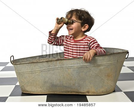 young pirate in an old bathtub with binoculars