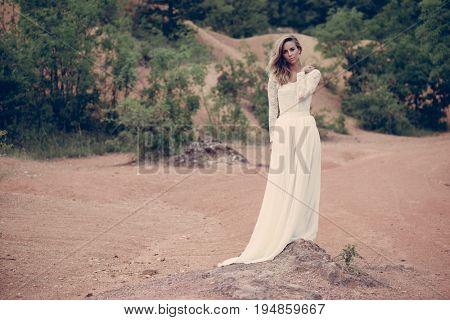 Beautiful Bride in white wedding dress outdoor
