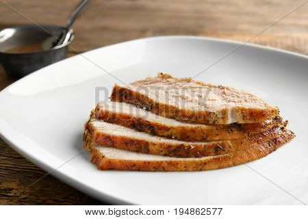 Delicious sliced turkey on plate, closeup