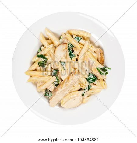 Chicken Alfredo Pasta with Spinach Isolated on White. Selective focus.