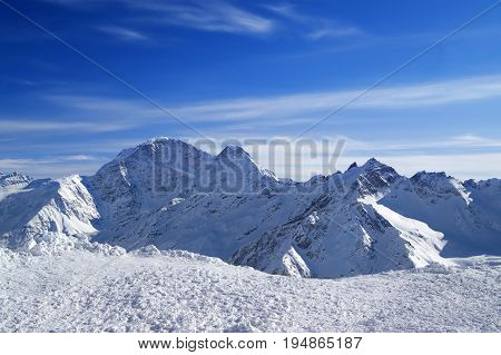 Caucasus Mountains in snowy winter. View on mount Donguzorun from mt. Elbrus.
