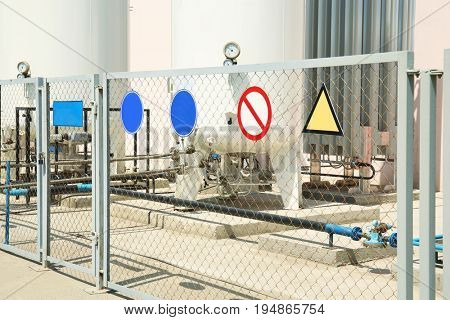 Prohibited area of production facility with warning signs