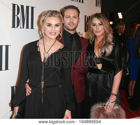 NASHVILLE, TN-NOV 3: (L-R) Rachel Bradshaw, Ty Graham and Sarah Davidson of Stella James attend the 63rd annual BMI Country awards on November 3, 2015 in Nashville, Tennessee.