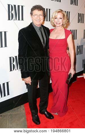 NASHVILLE, TN-NOV 3: Recording artist Mac Davis (L) and wife Lise Kristen Gerard attend the 63rd annual BMI Country awards at BMI on November 3, 2015 in Nashville, Tennessee.