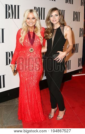 NASHVILLE, TN-NOV 3: Recording artist Heather Morgan (L) and guest attend the 63rd annual BMI Country awards at BMI on November 3, 2015 in Nashville, Tennessee.