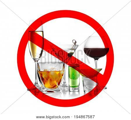 Different alcohol drinks in glasses with STOP sign on white background
