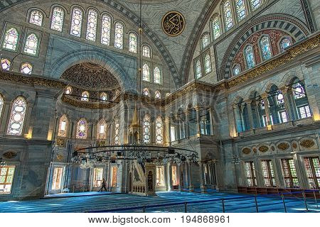 ISTANBUL, TURKEY - MAY 2, 2017: Interior of Nuruosmaniye Mosque, an Ottoman Baroque style mosque built in 1755, with a huge arches and many colored stained glass windows located in Fatih district