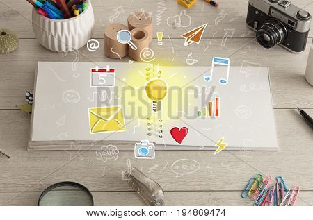 Open notebook on the floor with instruments nearby and icons symbols on it