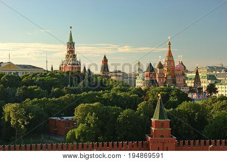 Evening view on Moscow Red Square Kremlin towers red square wall stars and Clock Kuranti Saint Basil Cathedral church. Panorama from bell tower. Moscow holidays vacation famous sightseeing tours